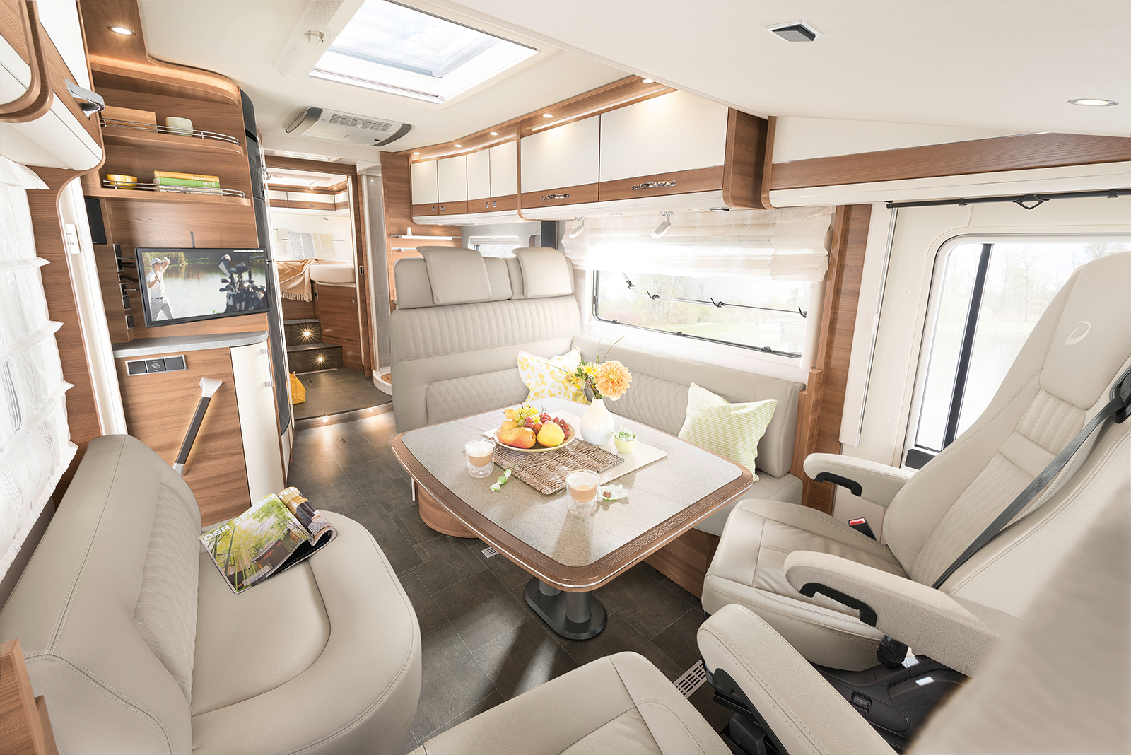 This is the premium class: ample room throughout the vehicle – enjoy a luxurious sense of space from the seating lounge to the single beds in the rear