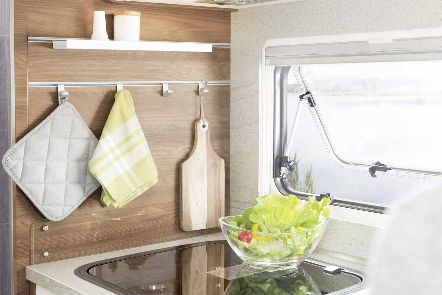 The kitchen boasts a range of practical and stylish solutions, such as the rail system