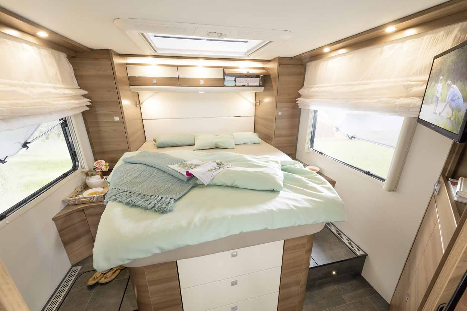 It doesn't get any more comfortable. The Queens bed is accessible from three sides.Left and right two large wardrobes offer additional storage space